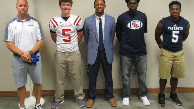 Shown from left is Coach Robert Mustar, and football players, Shaw Crocker, Lummie Young, Cadavius Gary and EJ Humphrey.