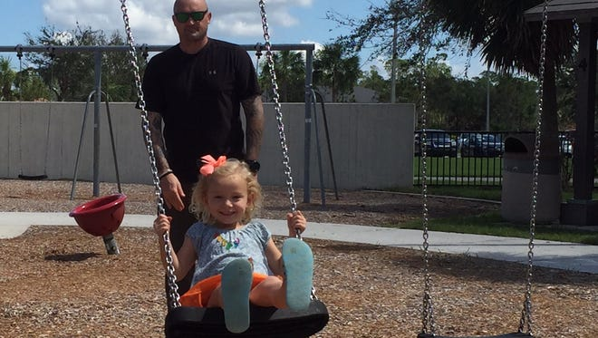 Nicholas Narvaez, 36, pushes his girlfriend's daughter, Alaina, 4, on a swing at North Collier Regional Park on Saturday, Sept. 16. A week after Hurricane Irma hit Collier County, residents are seeking a return to normality.