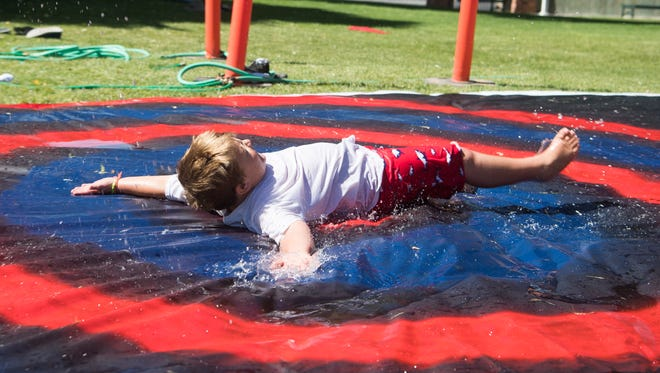 Children play at the Water Festival in Cedar City's Main Street Park Saturday, June 30, 2018. The festival raises awareness about conserving water in Southern Utah.