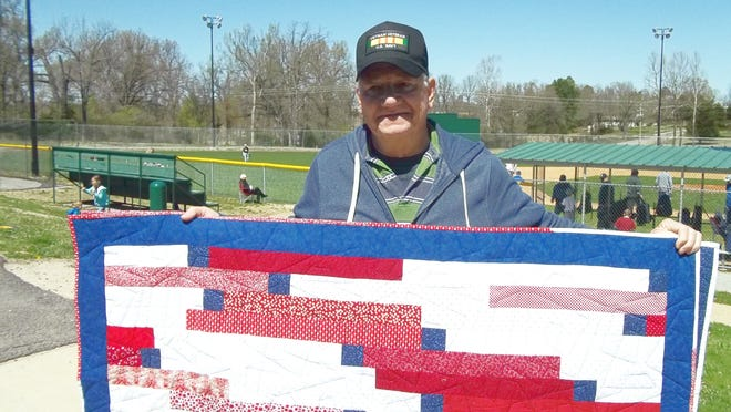 Local retired U.S. Navy veteran Larry Kelley displays the Quilt of Valor recently awarded to him by the Mountain Home Quilts of Valor. Kelley served during the Vietnam era.