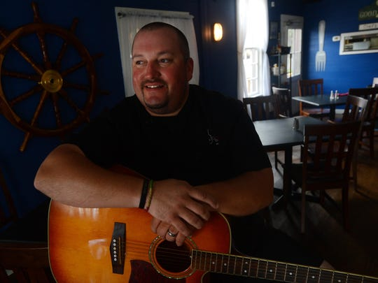 """Chef John """"Johnny Mo"""" Morrison is shown with his guitar in his restaurant Mallards at the Wharf as he discusses Music for the Hungry, an annual concert he first organized 10 years ago to benefit the Foodbank of the Eastern Shore. The concert is scheduled Saturday at Historic Onancock School."""