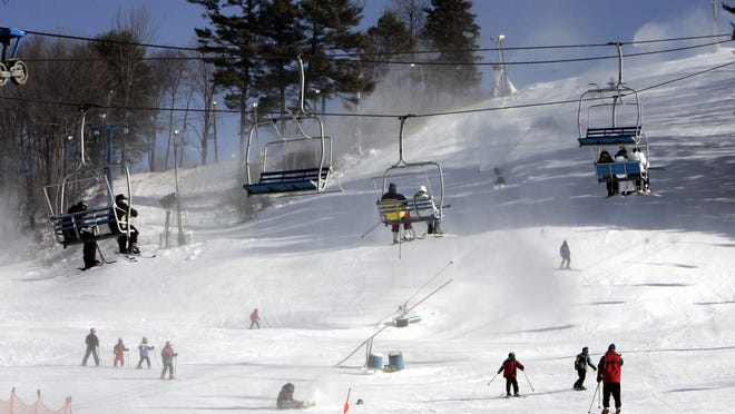 People enjoy the snow at Thunder Ridge in Patterson on Jan. 20, 2007. Putnam banker Dean Ryder declared that the lifts would again be cranked up in December at the beloved ski area.