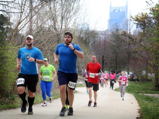 Runners in the 10K race make their way up the Cumberland