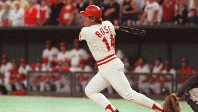 Cincinnati Reds Pete Rose  hits a line drive, Sept.11,1985, in Cincinnati to break Ty Cobb's all-time hit record.