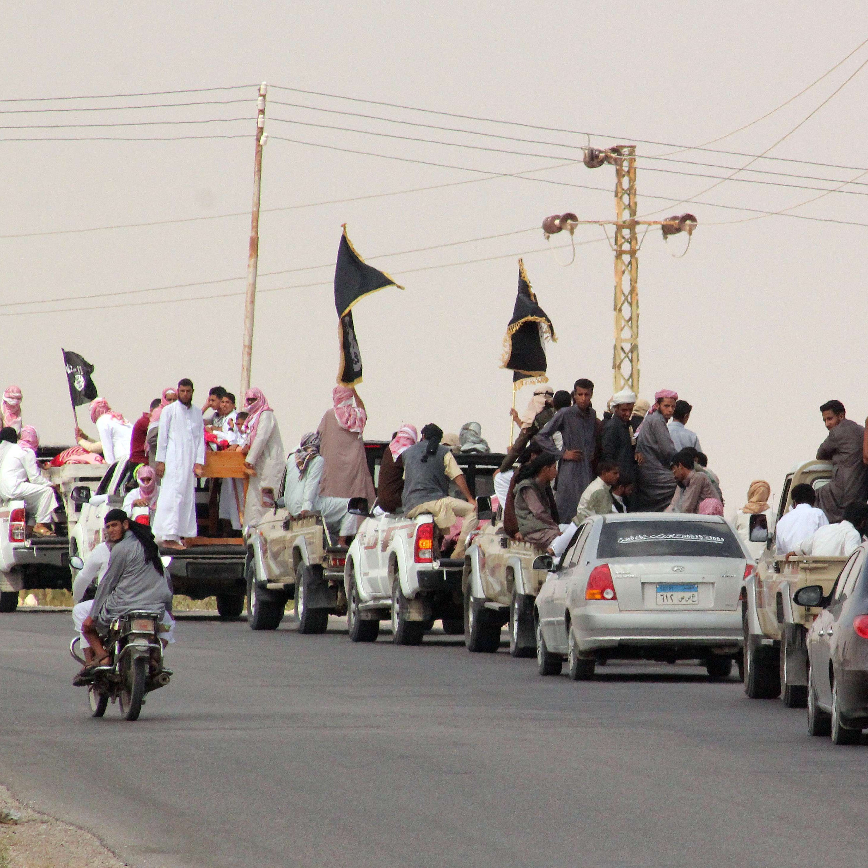 A funeral convoy carrying the bodies of four Egyptian militants drives through the small Sinai village of Sheikh Zuweid and several border towns in the north of the Sinai peninsula on Aug. 10. The Egyptian militant group Ansar Beit al-Maqdis said four of its members belonging to Sinai tribes had been killed by Israeli drones on Aug. 9.
