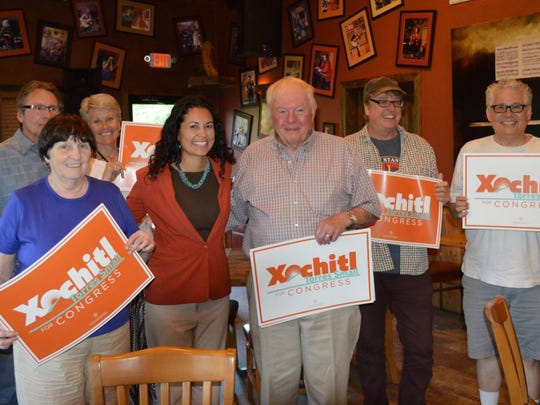 Democratic candidate Xochitl-Torres Small was joined by supporters at a recent meet and greet at Sacred Grounds