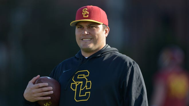Marques Tuiasosopo, who has spent nearly a decade as an assistant at the Pac-12 level, has reportedly spoken to Nevada about its head-coaching job.