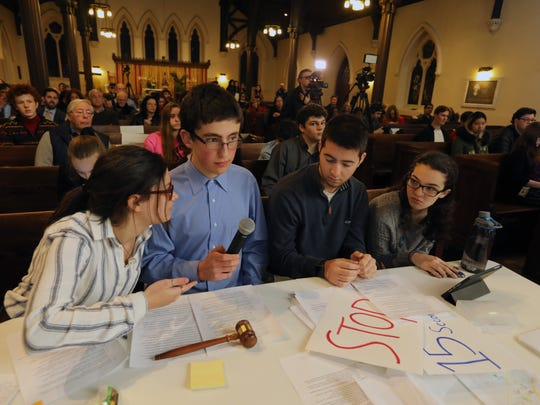 Student organizers Grace Turkewitz, left, Abe Baker-Butler, Andrew Sorota and Kelly Marx run a forum on gun violence in schools at Trinity Saint Paul's Episcopal Church in New Rochelle April 9, 2018.
