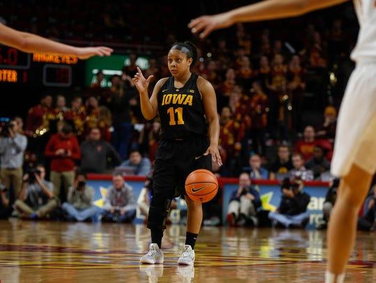 Iowa junior Tania Davis calls a play against Iowa State