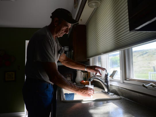 Gordon Lencioni of Sand Coulee fills up a coffee pot