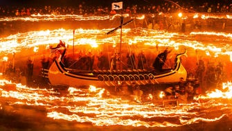 "Members of the Jarl Squad dressed in Viking costumes and holding flaming torches during the Up Helly Aa Viking festival, in Lerwick on the Shetland Isles, Britain, Tuesday Jan. 27, 2015.  Hundreds of costumed ""guizers"" carried flaming torches as they took to the streets of the Scottish island during the annual Up Helly Aa festival.  Originating in the 1880s, the tradition celebrates Shetland's Norse heritage which sees a 'Viking longship' dragged through the streets of Lerwick, led by a horde of people dressed as Vikings. (AP Photo / Danny Lawson, PA) UNITED KINGDOM OUT - NO SALES - NO ARCHIVE ORG XMIT: LON190"