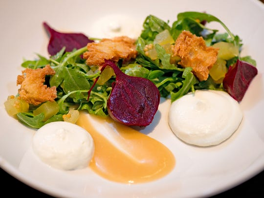 A salad of beets, goat cheese, arugula and apple mostarda from The Mercer OTR.