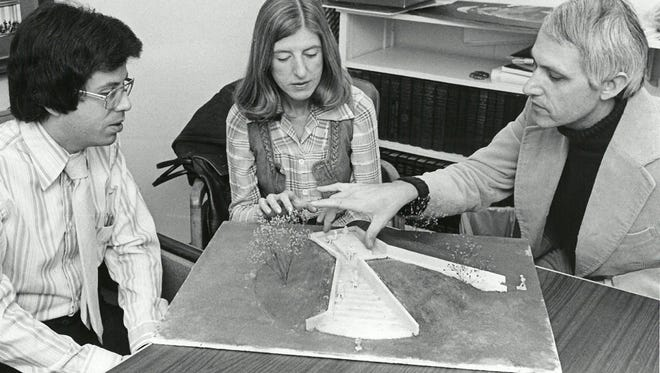 Jettie Ann Ward, center, chairman of the Bicentennial Commission's Time Capsule Committee, and Don Burkman, left, Municipal Auditorium manager and coordinator for the capsule project, look on as architect Michael O. Maloney explains his model of the Time Capsule Monument which will be the focal point of Bellevue Park.