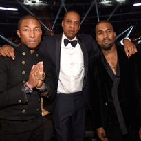 Pharrell Williams, Jay Z and Kanye West attend The 57th Annual GRAMMY Awards at STAPLES Center on February 8, 2015 in Los Angeles, California.