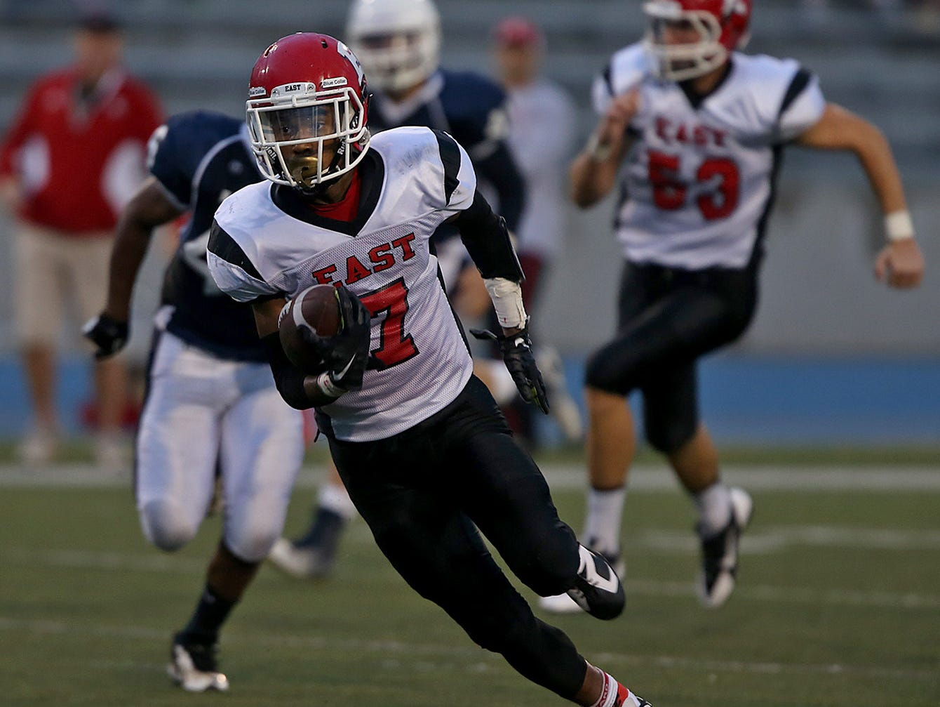 East junior Gerald Sama has returned two punts for touchdowns and rushed in another score for the playoff-bound Scarlets.