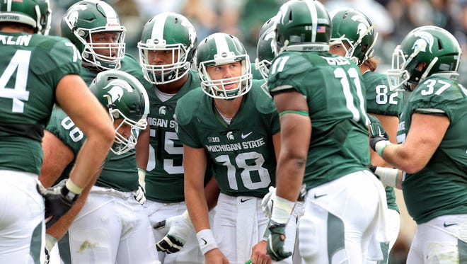 MSU quarterback Connor Cook (18) injured his shoulder against Maryland but said he expects to play Saturday against Ohio State.