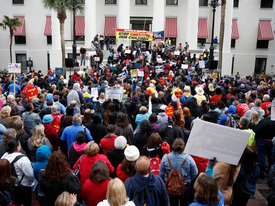 In this file photo, teachers and public education supporters from across the state of Florida gathered at the Capitol for an 'Enough is Enough' rally, protesting what they feel is excessive student testing, limited funding and flawed teacher evaluations.