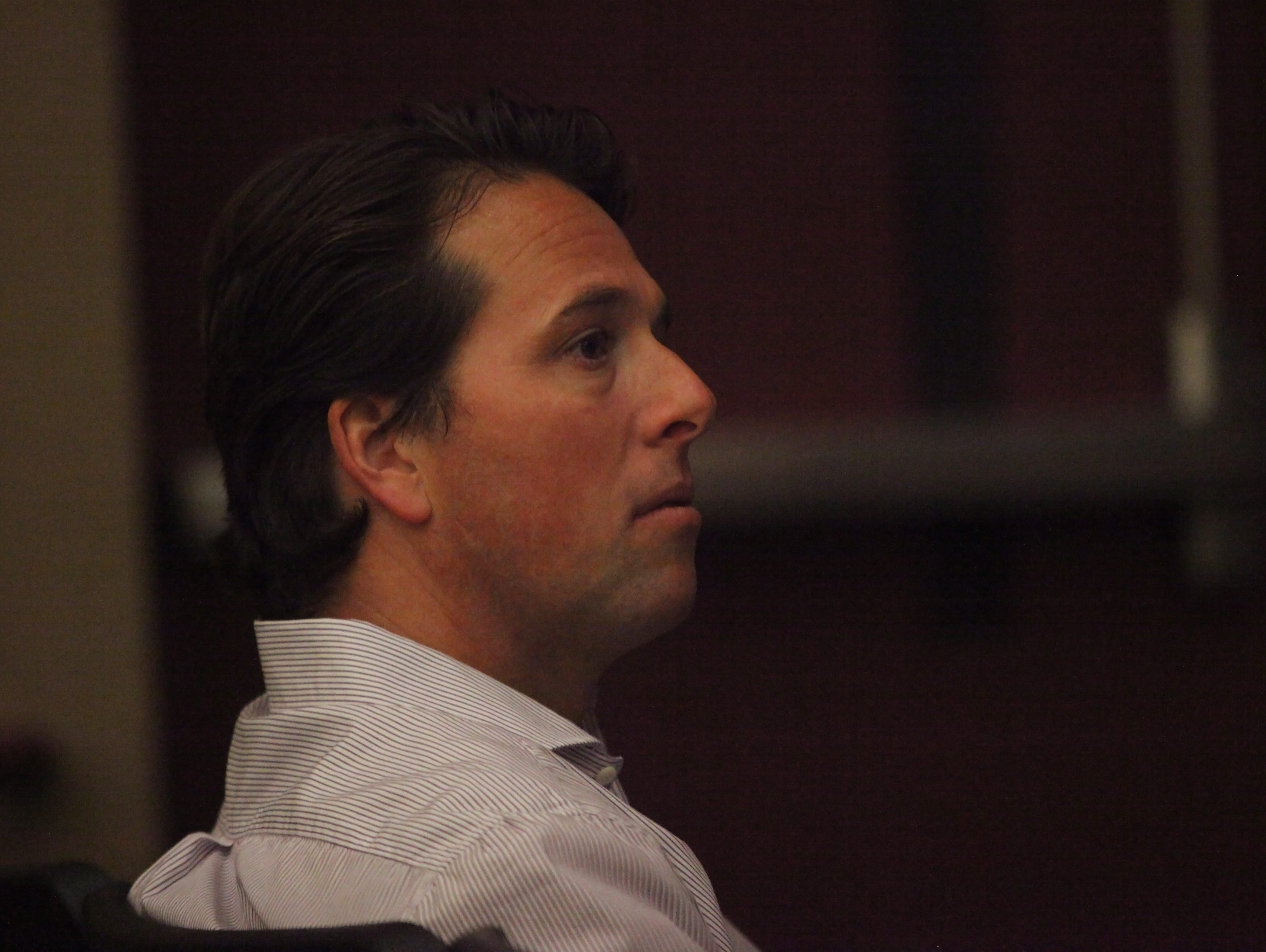 Louis Capano III listens as residents critique plans to develop Brandywine Country Club two years ago.