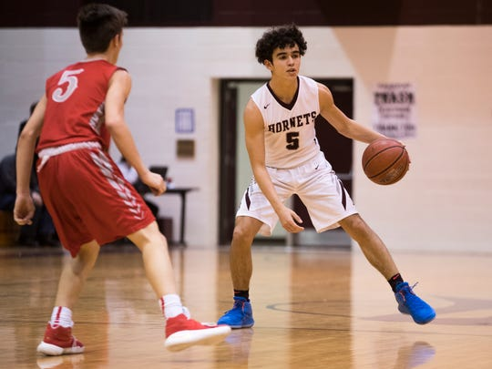 Flour Bluff's Dorian Bertero dribbles the ball during