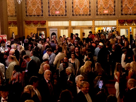 Attendees pack into the lobby during a red carpet movie