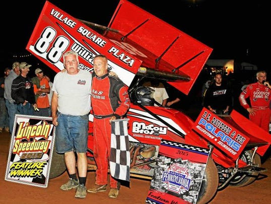 Todd Shaffer, right, stands with race promoter Fred Rahmer at the Legends race at Lincoln Speedway last Wednesday evening. All the drivers combined for over 1,500 feature wins.