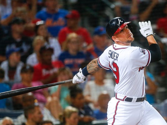 Atlanta Braves pinch hitter Brandon Snyder follows through on a three-run home run in the fifth inning of a baseball game against the New York Mets, Friday, June 24, 2016, in Atlanta. (AP Photo/John Bazemore)
