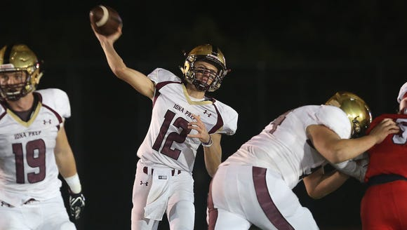 Iona quarterback Derek Robertson (12) passes against
