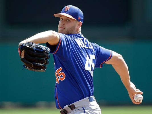 FILE - In this March 10, 2017, file photo, New York Mets starting pitcher Zack Wheeler throws in the first inning of a spring training baseball game in Kissimmee, Fla. Wheeler is set to start a series opener against Miami on Friday, April 7, his first big league appearance since Sept. 25, 2014. (AP Photo/John Raoux, File)