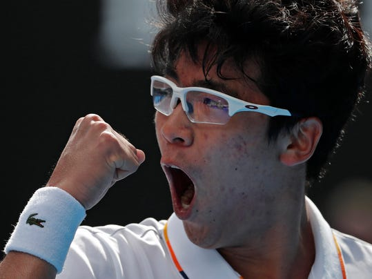 South Korea's Chung Hyeon reacts after winning a point against Germany's Alexander Zverev during their third round match at the Australian Open tennis championships in Melbourne, Australia, Saturday, Jan. 20, 2018. (AP Photo/Vincent Thian)