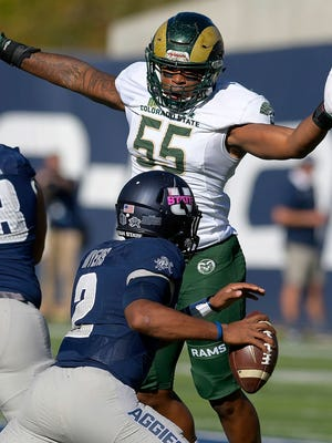Utah State quarterback Kent Myers (2) scrambles out of the pocket while as Colorado State linebacker Josh Watson (55) rushes in during an NCAA football game, Saturday, Oct. 7, 2017, in Logan, Utah. (Eli Lucero/Herald Journal via AP)
