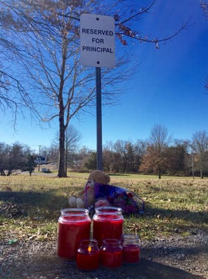 The parking space of Spring Hill Elementary principal Sharon Cantrell has been turned into a memorial site after her death on Saturday.