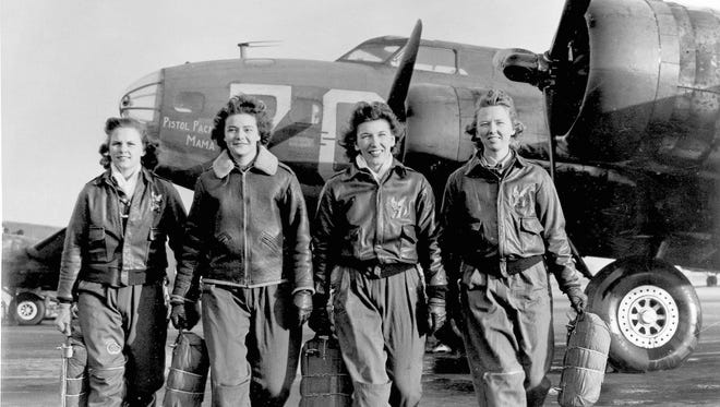 """In this historical photo, Frances Green, Margaret (Peg) Kirchner, Ann Waldner and Blanche Osborn leaving their plane, """"Pistol Packin' Mama,"""" at the four-engine school at Lockbourne AAF, Ohio, during WASP ferry training B-17 Flying Fortress."""