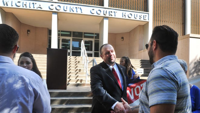 Wichita County Assistant District Attorney Dobie Kosub talks with a supporter Thursday morning after announcing that he is running for the 30th District Court Judge. The court's current jurist, Judge Bob Brotherton, has announced that he will not seek another term.