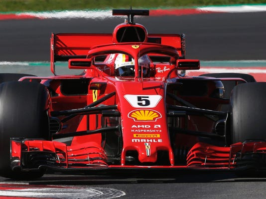 Ferrari driver Sebastian Vettel of Germany steers his car during a Formula One pre-season testing session in Montmelo, outside Barcelona, Spain, Wednesday, March 7, 2018. (AP Photo/Manu Fernandez)