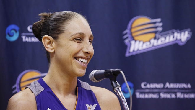 The Phoenix Mercury's Diana Taurasi smiles as she speaks during a news conference on May 9 at the team's media day in Phoenix. Taurasi is back for the Phoenix Mercury after sitting out last year to rest.