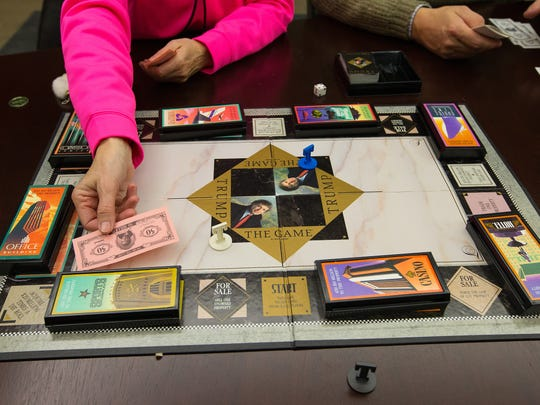 """Kathy Schult plays """"Trump The Game"""" that her friend, Denise Bartlett, bought while visiting Trump Palace in Atlantic City in 1989."""