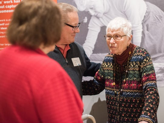 "Lois Main Templeton (right) greets the public at the March opening of ""Lois Main Templeton: A Reinvented Life,"" an Indiana State Museum exhibit of approximately 20 of her paintings created from the  early '80s to last year. The exhibit runs through Aug. 5."