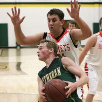 A Sheboygan Lutheran player looks to pass the ball while being guarded by a Cedar Grove player Dec. 1, 2015, in Sheboygan.