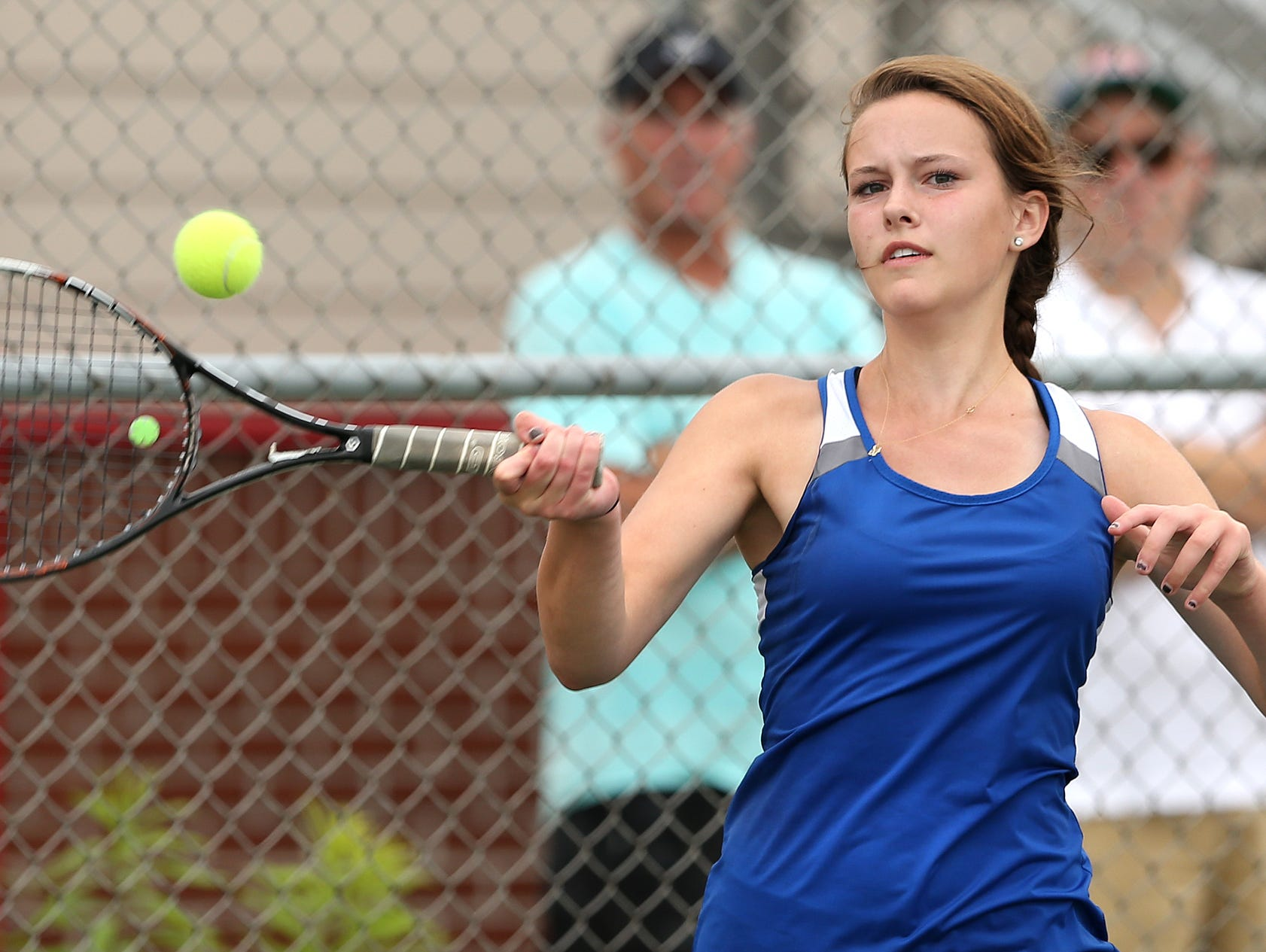 Carmel's Zoe Woods returns a shot during the IHSAA state tennis finals held at North Central High School on June 6, 2015.