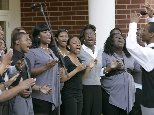 Nathaniel Tanner, right directs the FAMU Gospel Choir's performance at a Black History Month event celebrating the African American military experience at the Meeks Archives on FAMU campus on Friday, Feb. 18, 2011 in Tallahassee, Fl.