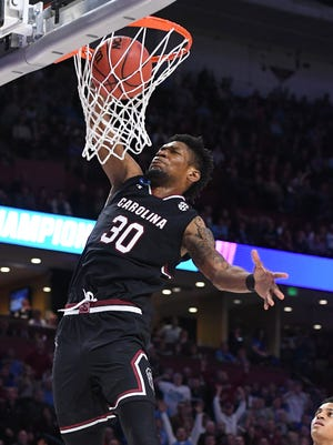 South Carolina forward Chris Silva (30) dunks against Duke during the 2nd round of the NCAA Tournament at Bon Secours Wellness Arena in downtown Greenville on Sunday, March 19, 2017.