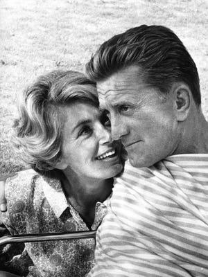 A candid shot of Kirk and Anne Douglas.