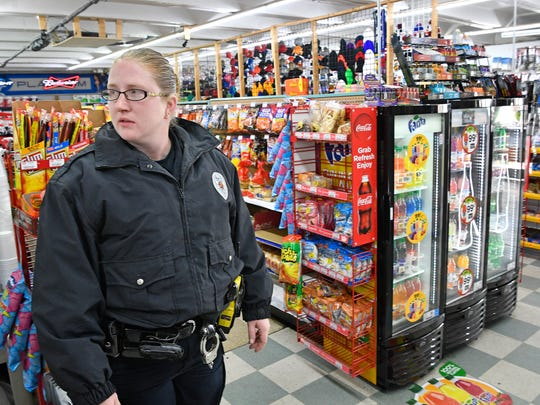Springfield Police Corporal Martha Moore walks through the Stop One Market in Springfield. Moore is staying in a job where gang members threaten violence against officers and crowds of residents responding to police calls trying to draw a reaction from officersWednesday Nov. 22, 2017, in Springfield, TN