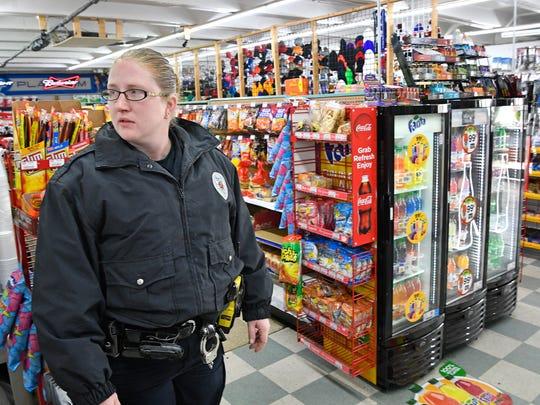 Springfield Police Corporal Martha Moore walks through