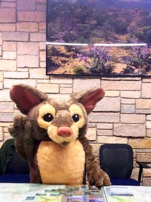 The unnamed mascot greets visitors at the park's Visitor Center.