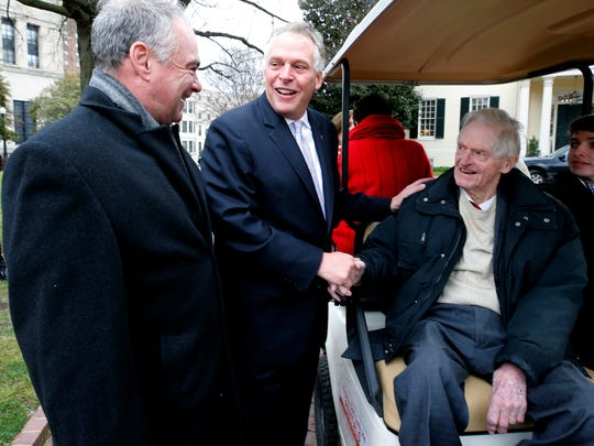 Former Virginia governor, U.S. Sen. Tim Kaine, left, and Gov. Terry McAuliffe, center, talk with Kaine's father-in-law, former Gov. A. Linwood Holton, right, before inaugural ceremonies at the State Capitol in Richmond, Va., on Saturday, Jan. 13, 2018.