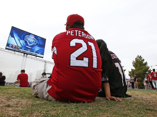 Arizona Cardinals fans watch the action at the draft party on Thursday, April. 27, 2017 on the great lawn at University of Phoenix in Glendale, Ariz.