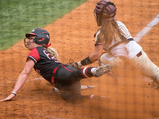 UL's Casidy Chaumont slides safely home for a run during the Cajuns' doubleheader sweep of ULM on Saturday at Lamson Park.
