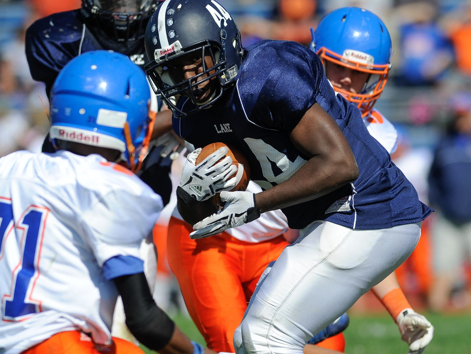 Lake Forest's #44 Amire White runs the ball in their 19-14 win over Delmar on Saturday at Lake Forest High School.