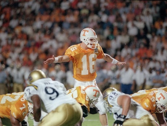 Tennessee quarterback Peyton Manning calls signals during the UCLA game on Sept. 7, 1996. The No. 2 Vols won 35-20 over the Bruins. Manning's 53-yard touchdown pass to Joey Kent in the fourth quarter clinched the Vols' victory and tied a school record of 36 shared with Heath Shuler and Andy Kelly. (MICHAEL PATRICK/NEWS SENTINEL)